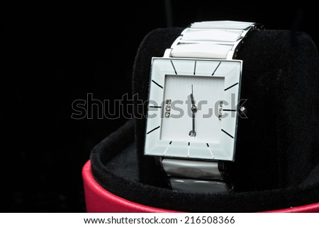 white clock on a black background. - stock photo