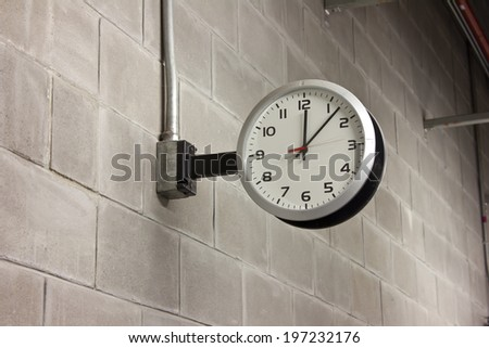 white clock on the wall - stock photo