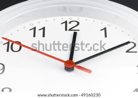 White clock showing time about twelve isolated - stock photo