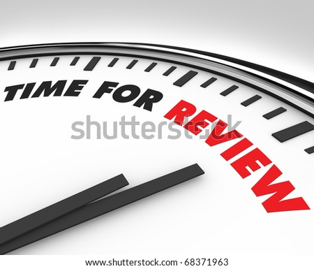 White clock with words Time for Review on its face - stock photo