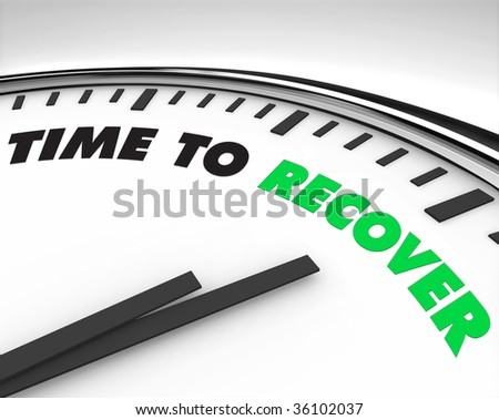 White clock with words Time to Recover on its face - stock photo