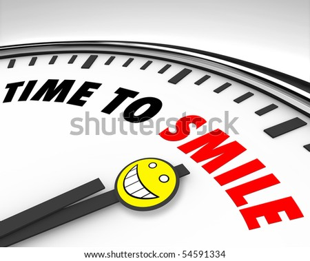 White clock with words Time to Smile and a happy face - stock photo