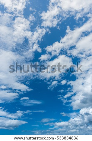 White cloud blue sky background vertical composition.