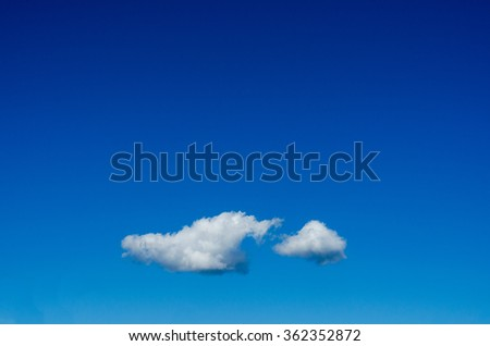white cloud floating on clear blue sky - stock photo