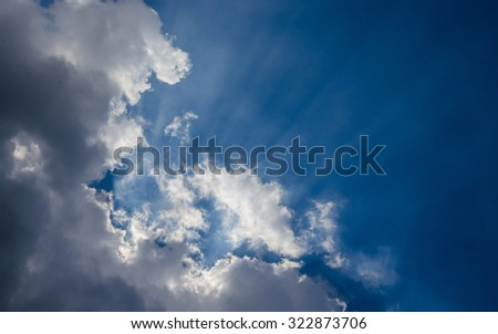 white cloud with sunlight on the blue sky