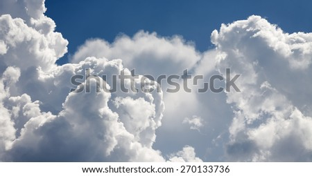White clouds and a beautiful blue sky day background - stock photo