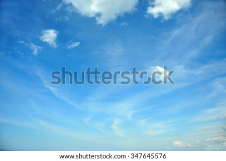 White clouds at a background of the blue sky
