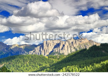 White clouds floating above rocky summits of the Catinaccio massif, Dolomite Alps, Italy - stock photo