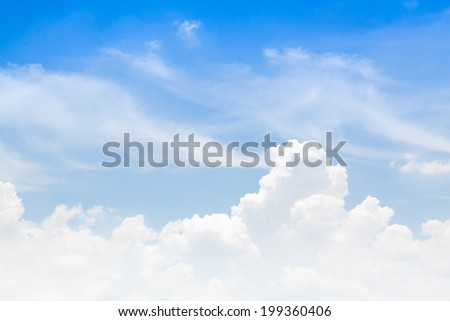 White clouds in a blue sky. - stock photo