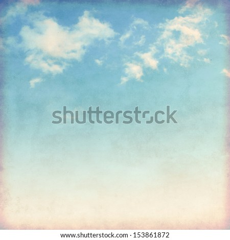White clouds in blue sky in grunge and retro style.  - stock photo