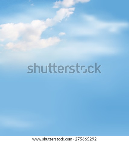 White clouds in the sky on blue background