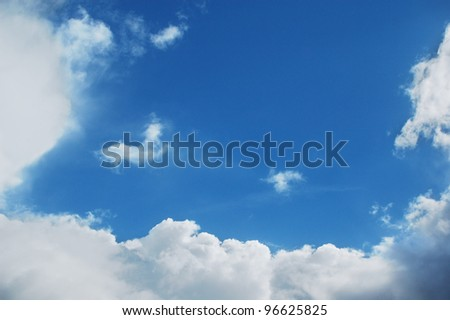 White clouds on the blue summer sky.