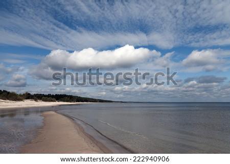White clouds over gulf of Riga, Baltic sea. - stock photo