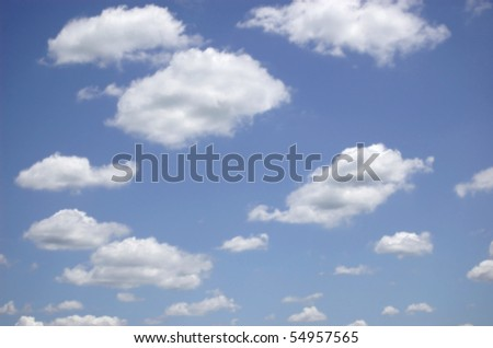 White clouds with visible depth in a blue sky - stock photo