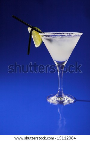 white cocktail with lime isolated on blue