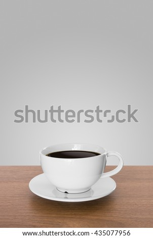 white coffee cup and hot espresso coffee on wooden table. light grey background - stock photo