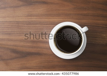 white coffee cup and hot espresso coffee on wooden table. top view - stock photo
