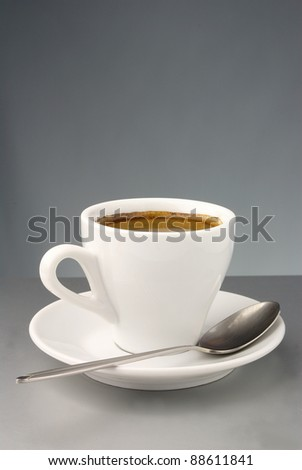 white coffee cup and saucer on the table - stock photo