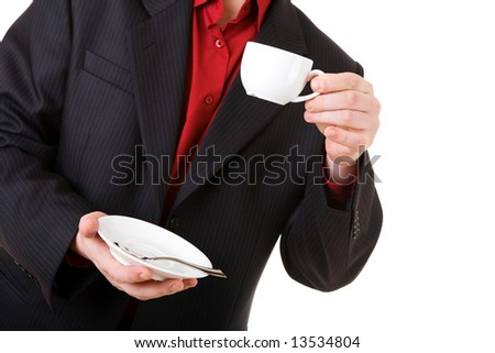 white coffee cup in the hand of the man - stock photo