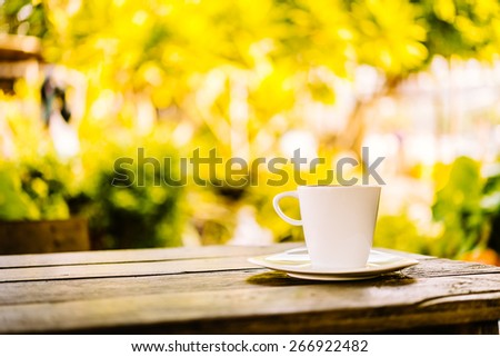 White coffee cup latte on wooden table - vintage sunlight effect style pictures - stock photo