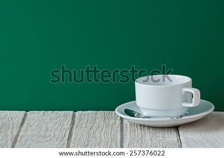White coffee cup on wooden table - stock photo