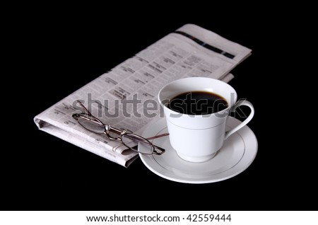White coffee cup with newspaper and lenses - stock photo