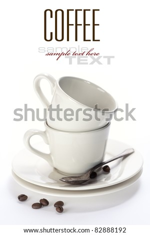 White coffee cups with saucers. Isolated on white (with sample text) - stock photo