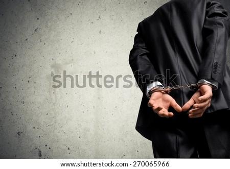 White Collar Crime, Handcuffs, Arrest. - stock photo