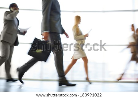 White collar workers hurrying to work at the beginning of working day - stock photo