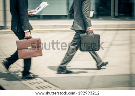 White-collars hurrying to work - stock photo