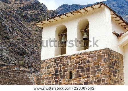 White colonial church in the historic town of Ollantaytambo in the Sacred Valley near Cusco, Peru - stock photo