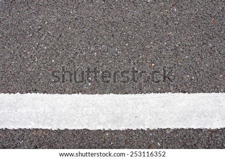 white color painted on the asphalt road as background - stock photo