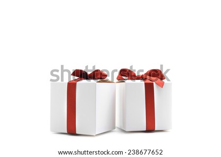 White colored gift boxes with red ribbons isolated