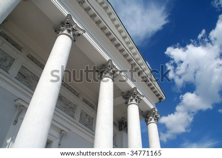 White columns and blue sky - stock photo