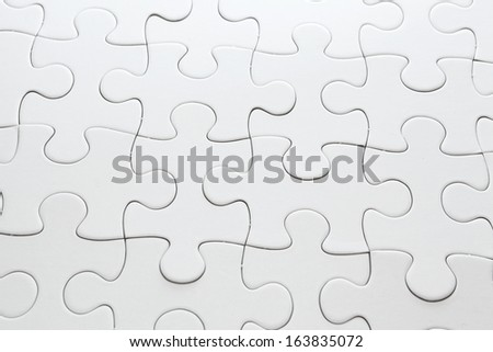 White completed puzzle - stock photo