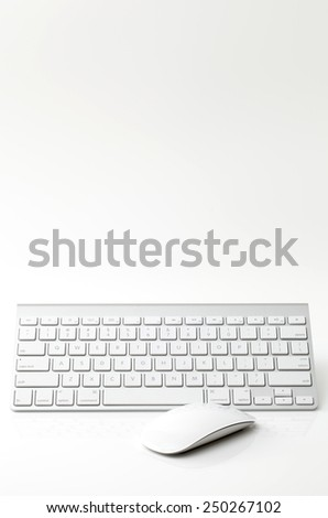 White computer mouse keyboard on white background - stock photo