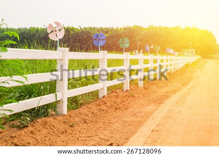 White concrete fence in horse farm field. Vintage filter. - stock photo