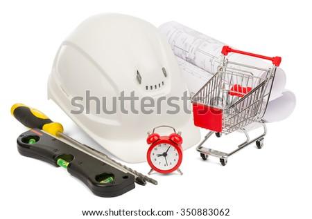 White construction helmet, alarm clock and shopping cart on isolated white background - stock photo