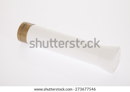 white container, skin cream, shampoo, scrub on white background