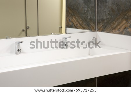 White Corian Sink Chrome Tap Wooden Doors and Dark Green Marble Textured Wall Tiles & White Corian Sink Chrome Tap Wooden Stock Photo (100% Legal ...