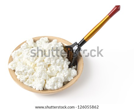 White cottage cheese in a bowl isolated on white background - stock photo