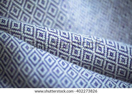 White cotton pattern on blue handmade fabric background