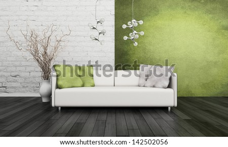 White couch in front of green wall - stock photo