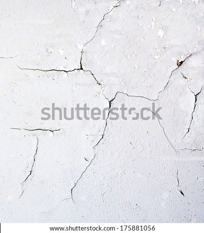 white cracked cement wall background - stock photo
