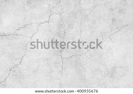 White cracked rough cement floor dirty texture background. Surface old building house gray tone. Empty wall weathered scratched. interior construction with aging dull. Plaster backdrop. - stock photo