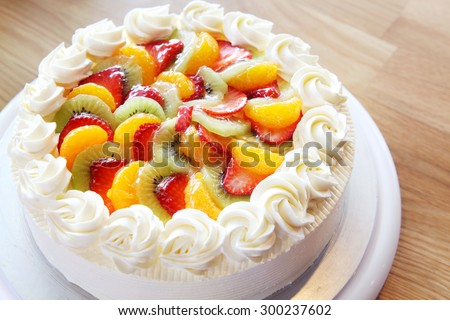 White cream cake with mixed fruity - stock photo
