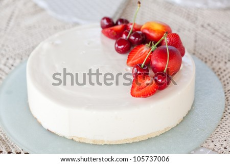 White Cream Icing Cake with Fruits - stock photo