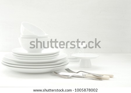 White Crockery and Cutlery as a background for copy text