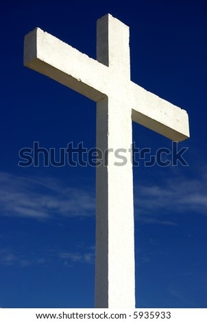 white cross against the blue sky