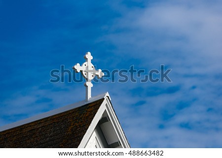 White cross on a church